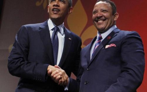 U.S. President Barack Obama (L) shakes hands with National Urban League President Marc Morial before his speech at the 2012 National Urban League Conference at the Ernst N. Morial Convention Center in New Orleans July 25, 2012.