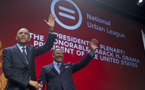 US President Barack Obama greets National Urban League President Marc Morial prior to speaking during the National Urban League convention at the Ernest N. Morial Convention Center in New Orleans, Louisiana, July 25, 2012.